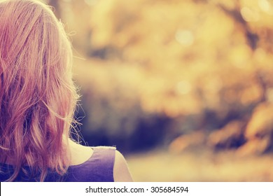 Woman looking away, summer background