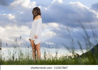 woman looking back over her shoulder