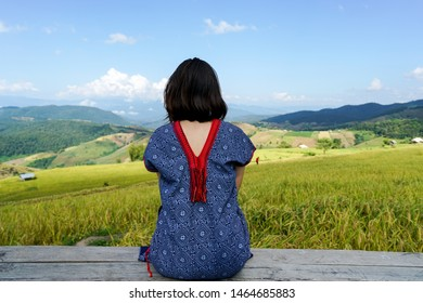 woman looking at beautiful rice terrace, woman travelling in Asia