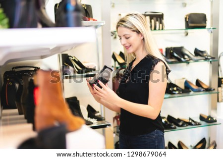 e3a52dad994 Woman Looking Best Shoes Shop Stock Photo (Edit Now) 1298679064 ...