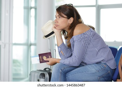 woman looking bored waiting for her flight