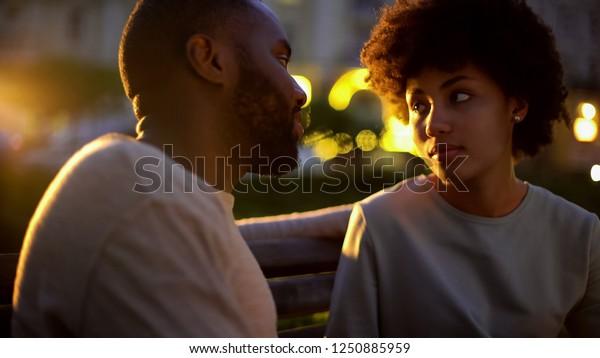 Woman looking at boyfriend with hope, outdoor date, misunderstanding, conflict