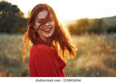woman looking at the camera with a beautiful smile with red lipstick