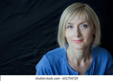 Woman looking at camera headshot studio portrait