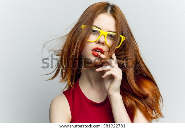 Woman looking at the camera on a light background