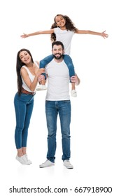 woman looking at camera while husband and daughter piggybacking isolated on white