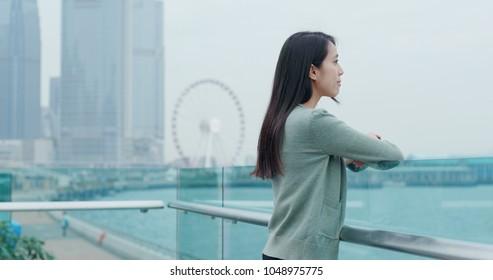 Woman looking at city of Hong Kong