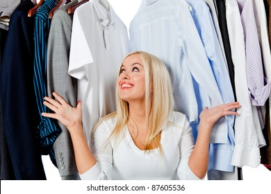 Woman looking for clothes in the wrong wardrobe - fashion concepts