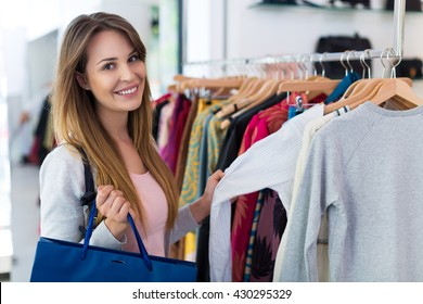 Woman looking at clothing in a boutique
