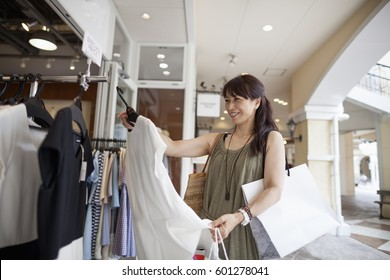 Woman looking at clothing in a shopping mall