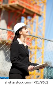 Woman looking up at construction site