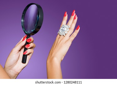 Woman looking at diamond with magnifying glass