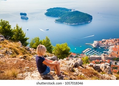 woman looking at the Dubrovnik Old Town and island Lokrum, Croatia