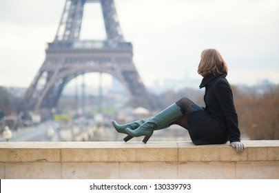 Woman looking at the Eiffel tower