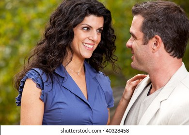 A woman looking happy at her husband / boyfriend - Focus on the woman