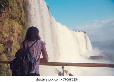 Woman looking at Iguazu Falls