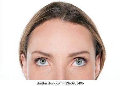 woman looking up - isolated - close up - half face