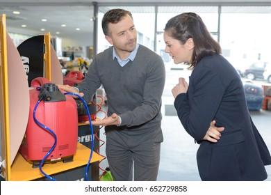 Woman looking at machine on display