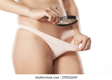 woman looking with a magnifying glass in her panties