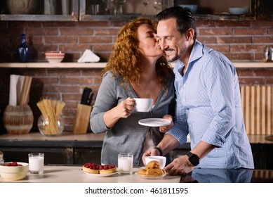 Woman looking at man and holding cup