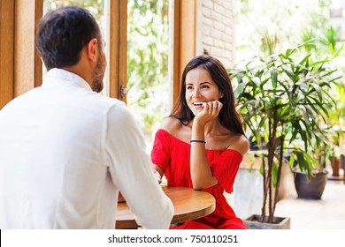 woman looking at the man on a date in cafe