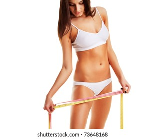 Woman looking at measure on white background