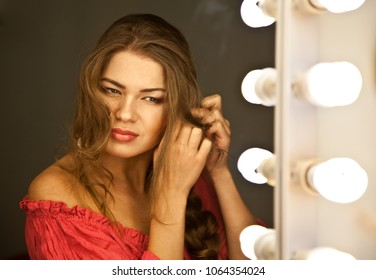 Woman looking to the mirror at studio