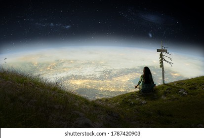 Woman looking on earth and meditating, fantasy concept