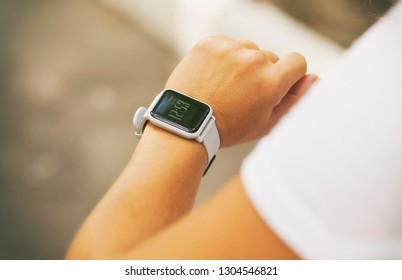 Woman is looking on her smart watches on her hand