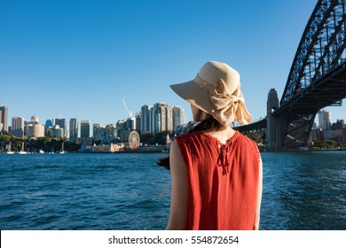 Woman looking on Sydney Harbour with Sydney Harbour Bridge on the background