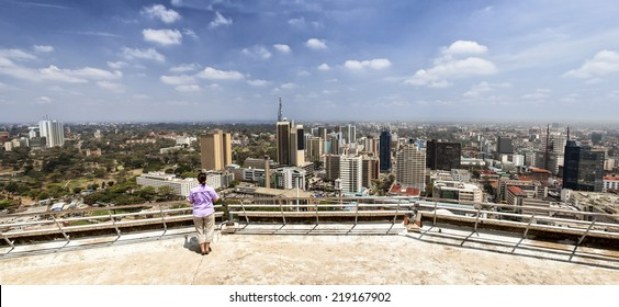 woman looking out over panoramic view of Nairobi, Kenya