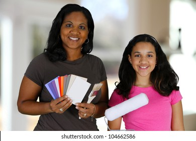 Woman looking at paint chips to use with daughter