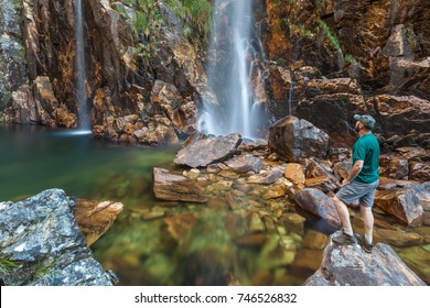 Woman looking to Parida Waterfall (Cachoeira da Parida) - Serra da Canastra National Park - Brazil