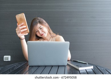 Woman looking phone and notebook for working, Business concept