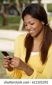 woman looking at phone, smiling