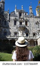 Woman looking popular landmark at Quinta da Regaleira, Sintra, Portugal.
