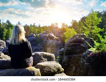 Woman looking at the sandstone rock in Prachovske skaly, Bohemian Paradise (Cesky Raj), Czechia. - Shutterstock ID 1844605384
