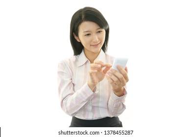 Woman looking at smart phone.