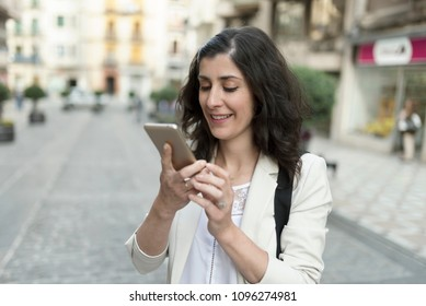 woman looking smartphone in the city