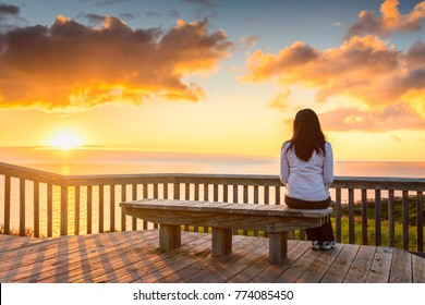 Woman looking at  sunset at Hallett Cove boardwalk in South Australia