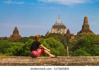 Woman looking at Thatbyinnyu Phaya in Bagan - Exploring the amazing temples in Bagan, Myanmar