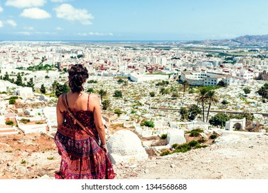 Woman looking towards Tetuan and its cemetery.
