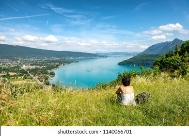 a woman looking a view of Annecy lake