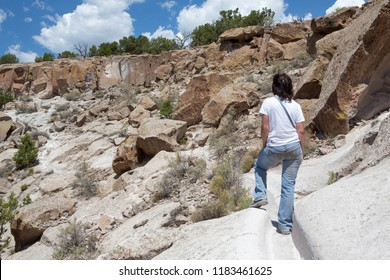 Woman looking at the view at The Bandelier National Monument, part of the Tsankawi Prehistoric Site, New Mexico, USA