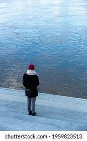 Woman looking at vistula river in Warsaw - Shutterstock ID 1959823513