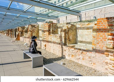 Woman looking at The wall of Topography of Terror in Berlin,Germany