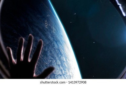 Woman looks at Earth planet through the spaceship porthole. Elements of this image furnished by NASA