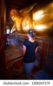 Woman Looks at Golden Statue Wat Phra Chetuphon Reclining Buddha Bangkok Thailand