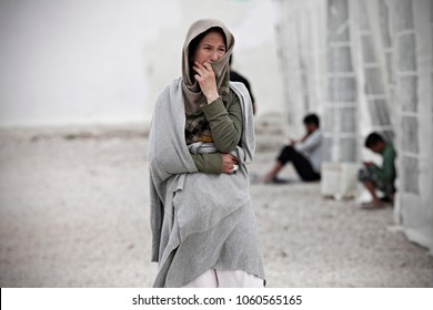 A woman looks on at Eleonas refugee camp in Athens, Greece on Apr. 9, 2016