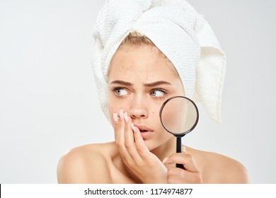 a woman looks puzzled towards the club in her hand problems with facial skin